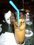 My half-finished Frappe, the national coffee drink of Greece, not unlike a drug in liquid form.